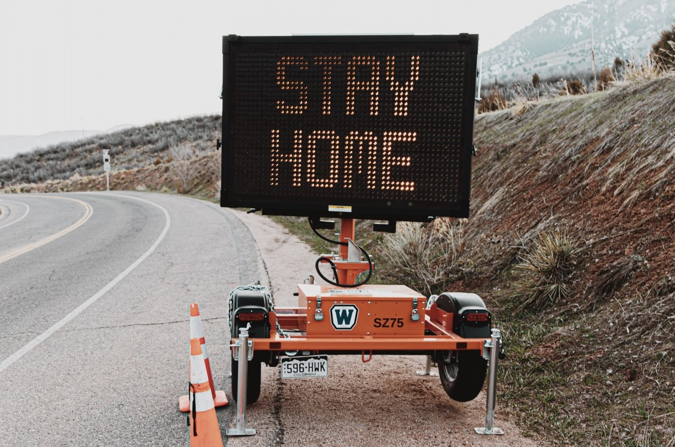 "Sign on highway saying ""Stay Home"""
